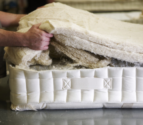 Natural Fillings Being Layered Into A Mattress