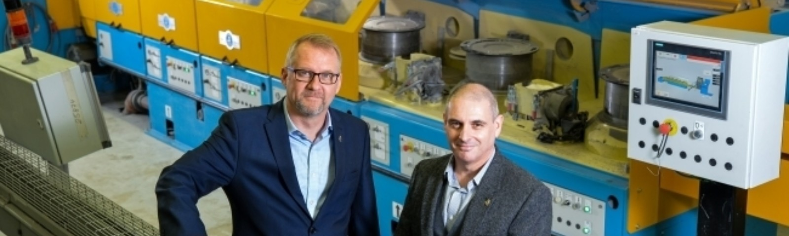 Simon Spinks Managing Director of Harrison Spinks and Richard Essery Managing Director of Harrison Spinks Components at the wire drawing line e1524080633435